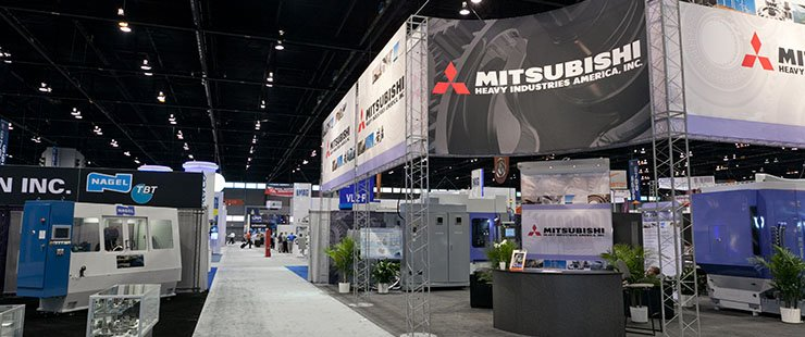 A nose-in-the-tent peek at the booths featuring mechanical motion components....